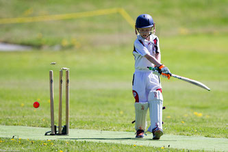 Young Swiss cricketer at the U11 age group loses his wicket at the Junior Cricket Festival in Zuoz, Switzerland