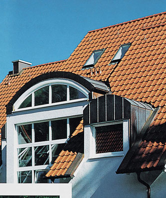 High-pitched roof combined with metal-clad dormer windows