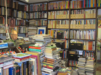 Kampintorin Antikvariaatti - owner Timo Surojegin surrounded by some of his 40,000 books