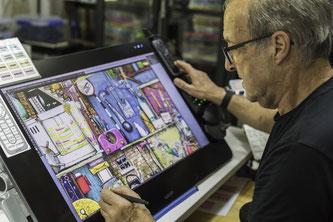 Der Puzzle-Illustrator Colin Thompson bei der Arbeit