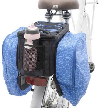 Eine integrierte Regenhülle schützt die Tasche vor Regen oder Schmutz.
