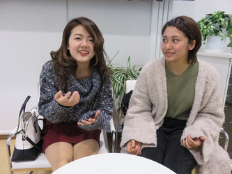 Koike (left) and Nishii speak during an interview with Hakumon Herald.