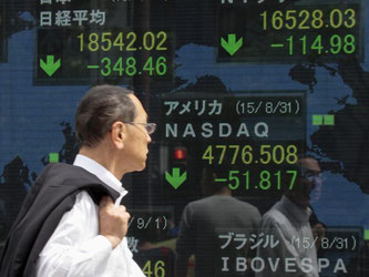 Die aktuellen Schwankungen auf den Finanzmärkten zeigen, wie rasch Risiken von einer zur nächsten Volkswirtschaft übergreifen können. Foto: Kimimasa Mayama/Archiv