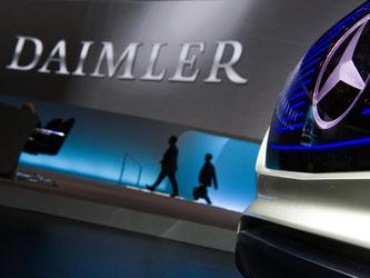 Daimler-Logo und Mercedes-Stern. Foto: Soeren Stache/Archiv