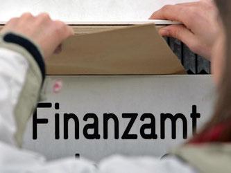 Steuern: Anleger können Verluste aus verfallenen Optionen beim Fiskus steuermindernd geltend machen. Foto: Jan Woitas