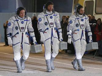 Astronaut Scott Kelly (links) und die Kosmonauten Gennady Padalka und Mikhail Kornienko. Foto: Sergei Ilnitsky