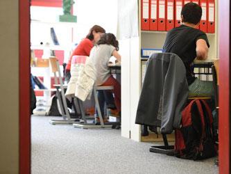 Schüler sitzen in der Gemeinschaftsschule. Foto: Felix Kästle/Archiv