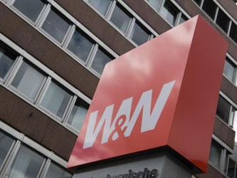 Das Logo der Wüstenrot & Württembergische-Gruppe auf einem Schild. Foto: Marijan Murat/Archiv