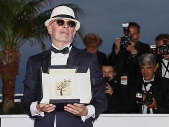 Jacques Audiard mit der Goldenen Palme. Foto: Ian Langsdon