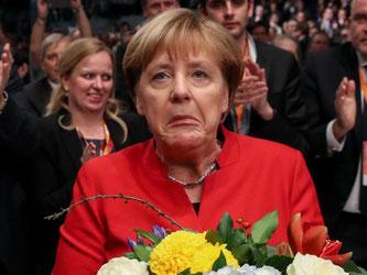 Hm, naja... Bundeskanzlerin Angela Merkel nach ihrer Wiederwahl als CDU-Chefin beim Bundesparteitag in Essen. Foto: Michael Kappeler