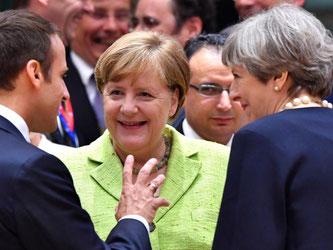 Bundeskanzlerin Merkel zusammen mit dem französische Präsidenten Macron und der britischen Premierministerin May beim Gipfel in Brüssel. Foto: Geert Vanden Wijngaert