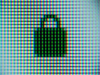 Mehrere Pixel bilden ein Vorhängeschloss als Sicherheitssymbol. Foto: Lino Mirgeler/Archiv