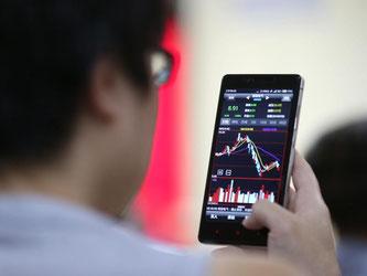 Chinas Börsen leiden unter Turbulenzen. Foto: Wu Hong