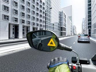Sicherheit wie beim Auto: Immer mehr aus dem Auto bekannte Sicherheitssysteme wie der Totwinkel-Assistent halten auch beim Zweirad Eingzug. Foto: Bosch