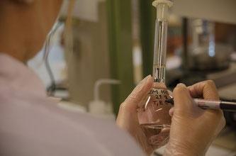 Chemiker beschreib Messglas