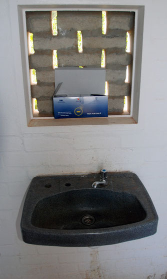 In 2007 2,000 Imizamo Yethu residents were lving with HIV/AIDs: free condoms in a public toilet on the Cape Peninsula