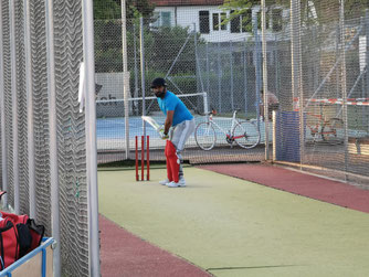 A lone batsman against a bowling machine