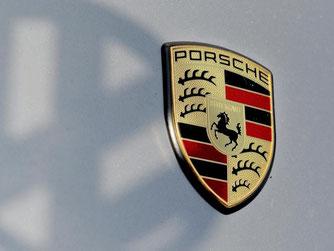 Porsche-Logo. Foto: Franziska Kraufmann/Archiv