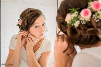 Hochzeitspaar  küsst sich hinter Brautstrauß