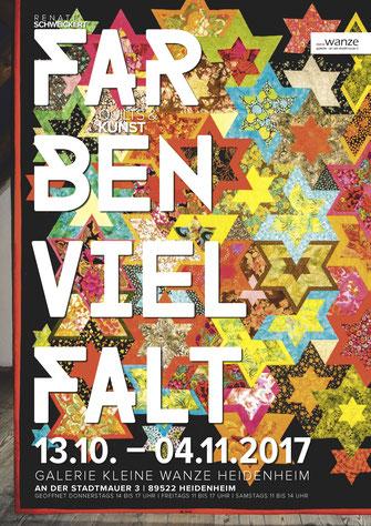 Hängender Quiltteppich mit buntem Muster, Schrift Farbenvielfalt