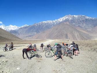 Mountain Bike Yoga Tour in Nepal, stretching amidst snow covered mountains; Mountain Bike Yoga Vaccation in Nepal