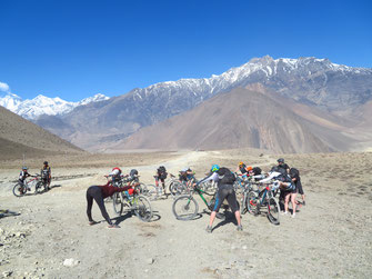 Mountain Bike Yoga Tour in Nepal, stretching amidst snow covered mountains; Mountain Bike Yoga Vaccation in Nepal