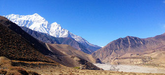 Jomsom Muktinath Yoga Trek in Nepal, Himalaya snow covered peaks and valley in Lower Mustang; Yoga Vaccation in Nepal, Yoga Trekking in Nepal