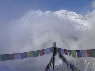 Prayer flags and snow mountains