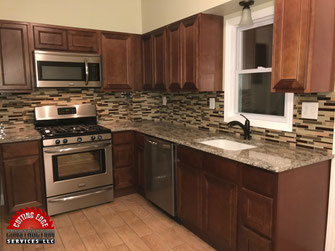 kitchen remodel, granite countertops, tile backsplash, ceramic tile, plank flooring, tile flooring, stainless steel, medium brown cabinets, walnut cabinets, new kitchen cabinets, countertops, granite, tile flooring, glass tile,