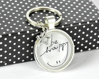 Schlüsselanhänger versilbert mit Sinnspruch Be Happy