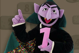 The Count from Sesame Street holding the number one