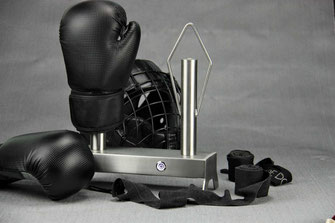 stainless steel boxing glove dryer with boxing gloves, helmet and black handwraps on a grey background