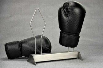 stainless steel boxing glove rack with gloves on a grey background