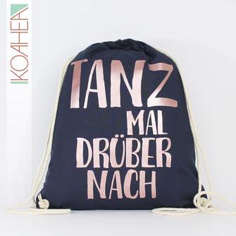 dunkelblauer Turnbeutel mit Spruch TANZ MAL DRÜBER NACH Farbe roségold Handlettering Design metallisch