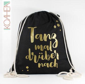 schwarzer Turnbeutel mit Spruch TANZ MAL DRÜBER NACH Farbe gold Handlettering Design metallisch