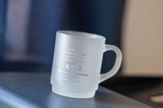 Foto zeigt Tasse mit Werbeaufdruck, Foto: Tom Wenig