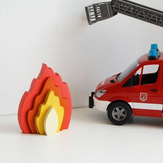 Puzzle en bois pour bébé flamme à emboiter. Puzzle unique fabriqué en France.