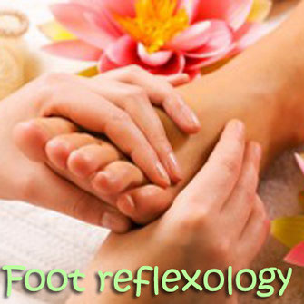Foot reflexology or Thai foot massage.