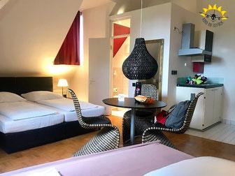 Geräumige Apartments mit Kochnische.