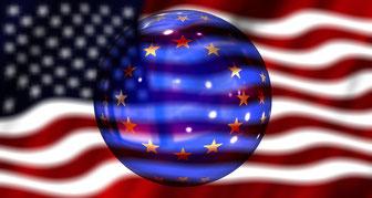EU-Kugel vor amerikanischer Flagge