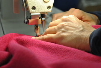 Specialized personnel cuts and sews the knitted fabrics.