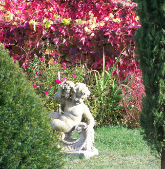 """""""Léonie"""" one of the putti in the garden"""