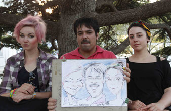 Emre with Lena and a friend holding their caricatures made by a local artist of Sevastopol, Crimean peninsula