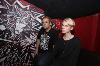 Emre Baykal with his assistent Nikita in front of the wall painting at the underground club Ionoteka in St. Petersburg, Russia