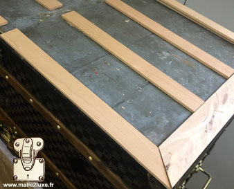Louis vuitton wooden slat underneath trunk