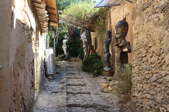 On the Vaucluse mountains, , Joucas and its narrow streets decorated with sculptures