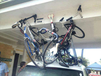damaged racing bikes due to roof transport underpass