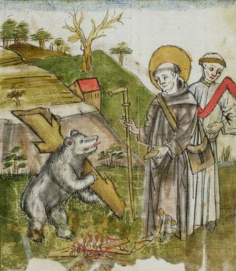 der Bär wirft brav das Holz ins Feuer und bekommt dann als Belohnung ein ganzes Stück Brot