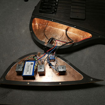 A mastercrafted Ulrich bassguitar with a noll 4 band equalizer mounted in a shielded housing