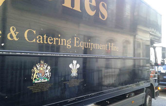 Royal Warrants on a truck. Photo: Men's Individual Fashion.